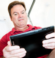 Man in Bathroom with Tablet PC - PhotoDune Item for Sale