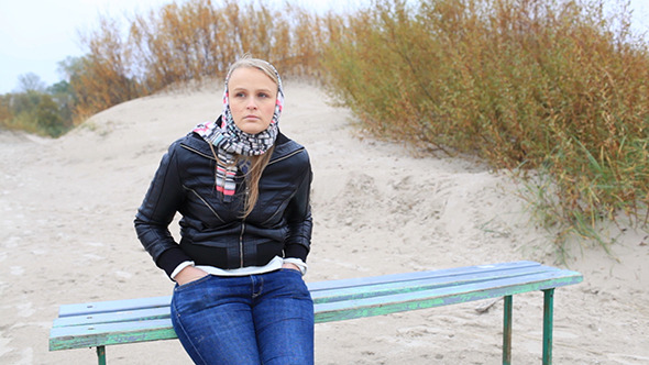 Young Girl is Sitting on a Bench Near the Sea VideoHive Stock Footage  People 3793982