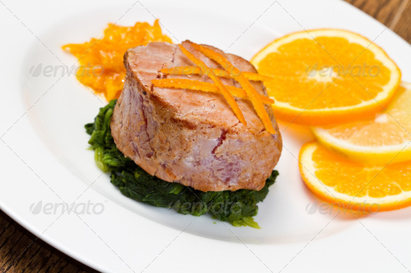 PhotoDune fried tuna fillet with fresh orange orange sauce and spinach 3794994