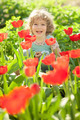 Child in flowery garden - PhotoDune Item for Sale