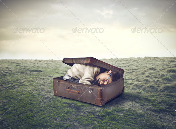 Crouched in the Suitcase - Stock Photo - Images