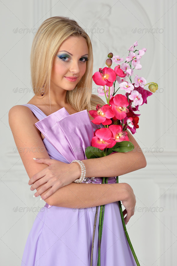 Beautiful woman with orchid - Stock Photo - Images