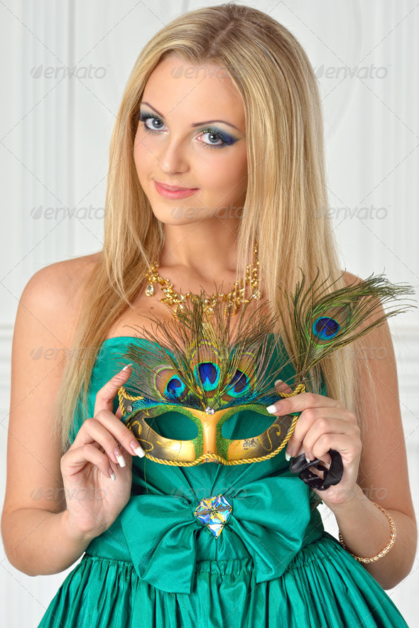 Beautiful woman in evening gown with carnival mask. - Stock Photo - Images