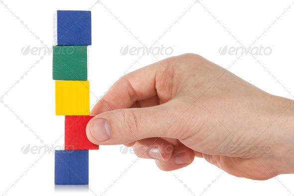 PhotoDune Hand Establishes A Wooden Cube 3825334