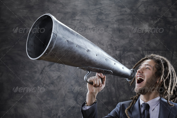 screaming into megaphone - Stock Photo - Images