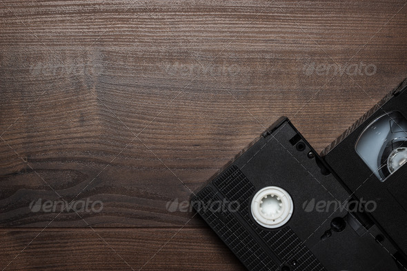 PhotoDune Old Retro Video Tape Over Wooden Background 3826789