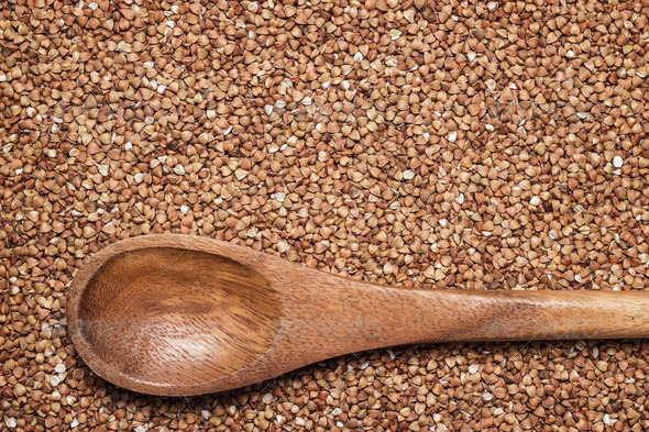 PhotoDune Buckwheat Background With Brown Wooden Spoon 3826784