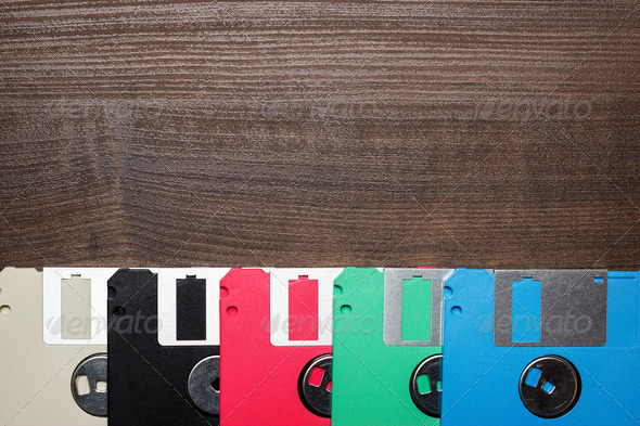 PhotoDune Retro Technology Concept Diskette On Wooden Background 3826797