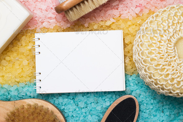 PhotoDune Bath Accessories And Blank Notepad Over Colored Sea Salt Background 3826824