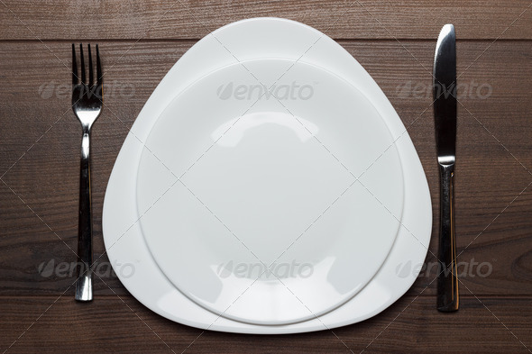 PhotoDune White Plates With Knife And Fork On Wooden Table 3826846