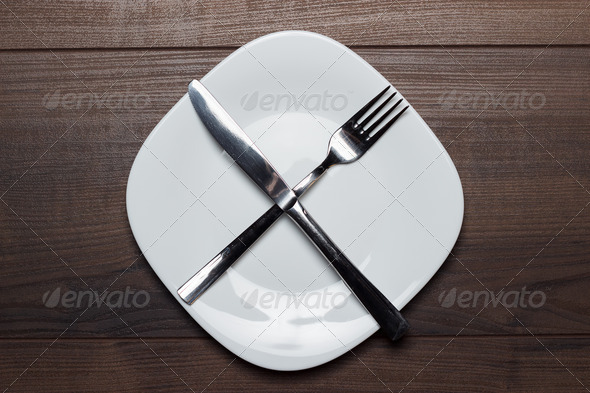 PhotoDune Dieting Concept White Plate With Knife And Fork Crossed 3826844