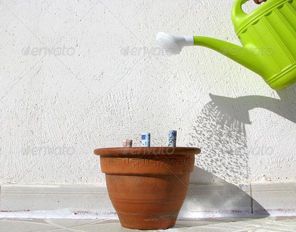 PhotoDune watering money 3826858
