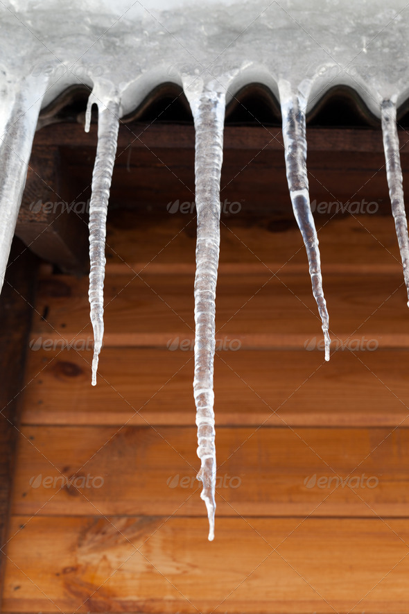 Icicles against wooden wall - Stock Photo - Images