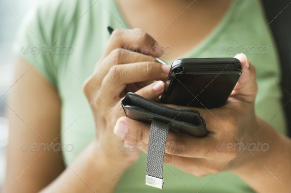 woman using smartphone - Stock Photo - Images