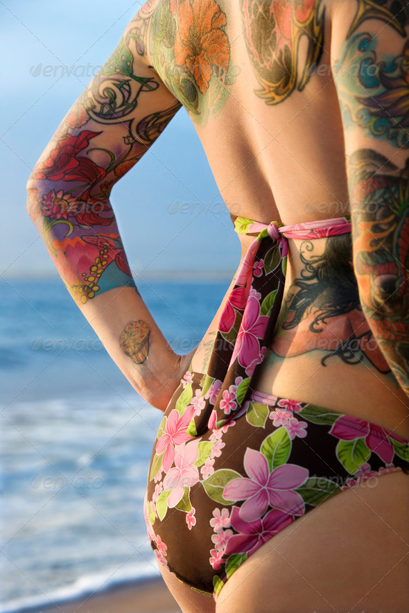 Tattooed woman in bikini - Stock Photo - Images