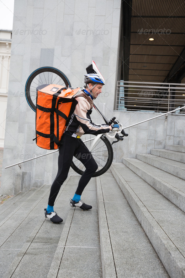 Male Cyclist With Courier Bag And Bicycle Walking Up Steps - Stock Photo - Images