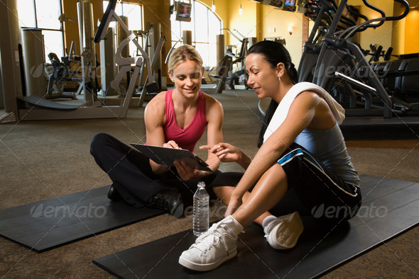 Woman with trainer at gym - Stock Photo - Images