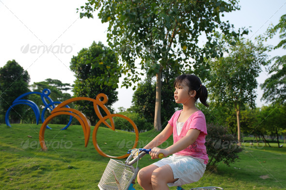 Asian kid riding bike - Stock Photo - Images