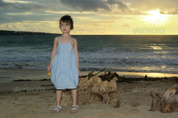 Asian kid on beach - Stock Photo - Images