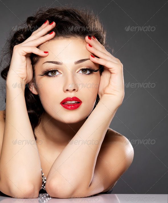 Beauty fashion woman with red nails and makeup - Stock Photo - Images