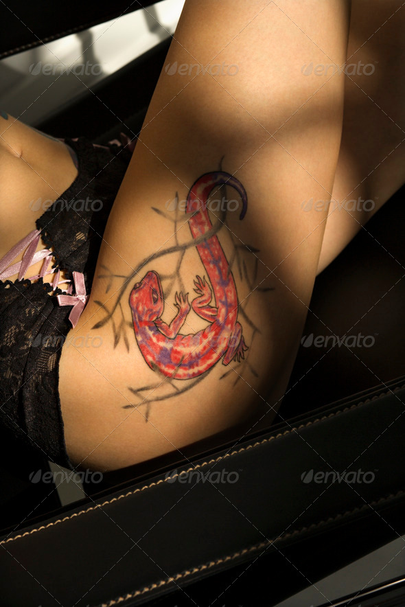 Lizard tattoo on thigh - Stock Photo - Images