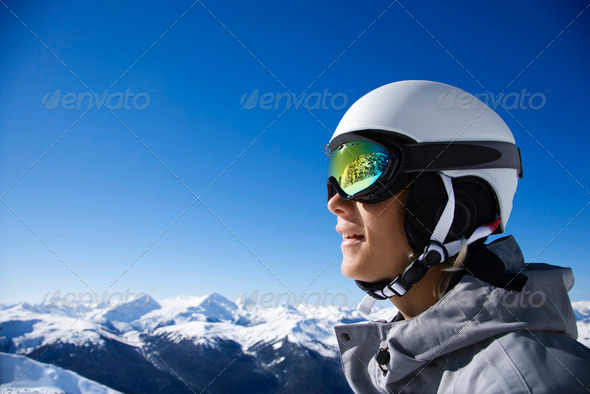 Boy snowboarder in mountains - Stock Photo - Images