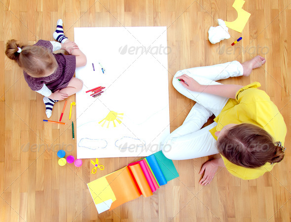 PhotoDune Young woman and little girl drawing together sitting on the floor Top view 3853386