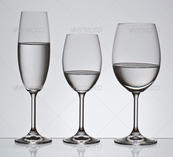 PhotoDune Bohemian crystal glasses filled with water; aligned backlit 3854134