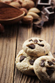 Chocolate chip cookies with ingredients in the background