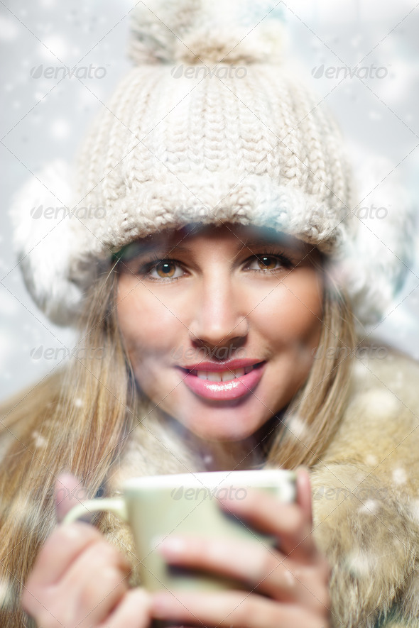 Beautiful young girl drinking coffee or tea - Stock Photo - Images