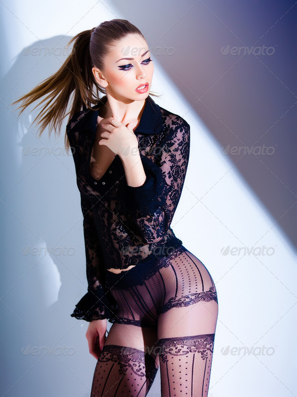 sexy model dressed in lace blouse and elegant tights posing - fa - Stock Photo - Images