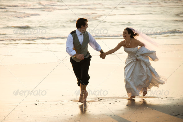 PhotoDune Bride and groom on beach 416599
