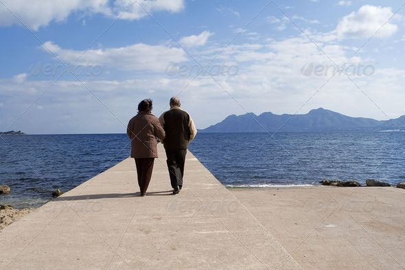 PhotoDune active senior couple walking by the sea on vacation 3866290