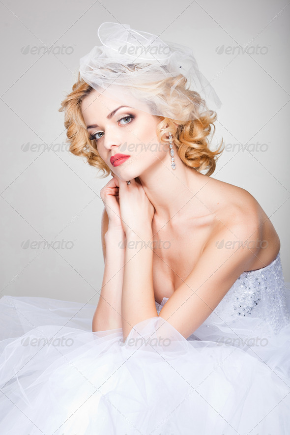 beautiful bride posing dramatic in the studio - Stock Photo - Images
