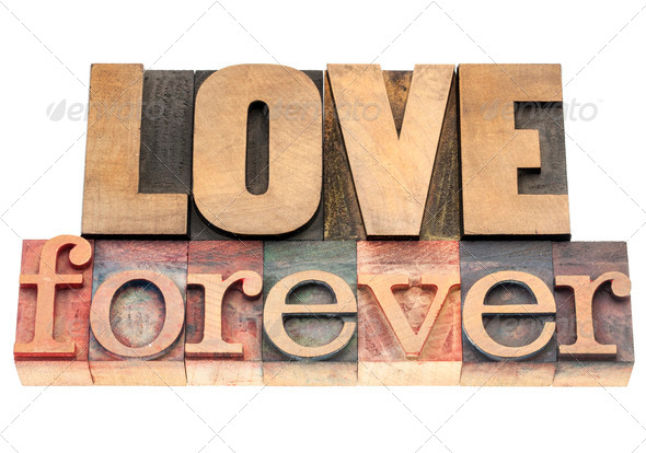 love forever in wood type - Stock Photo - Images
