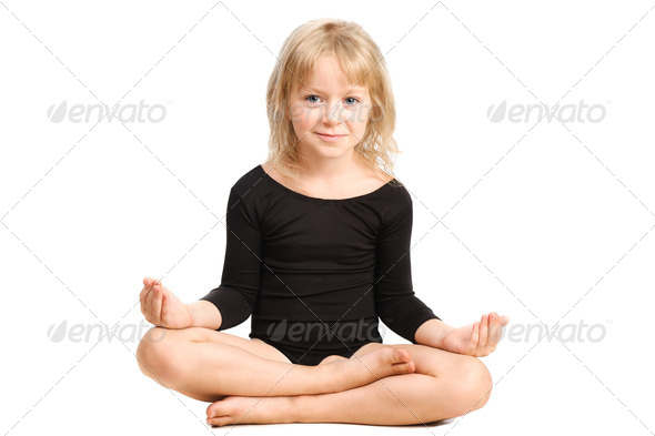 PhotoDune cute little girl making yoga relaxing pose isolated on white 3880065