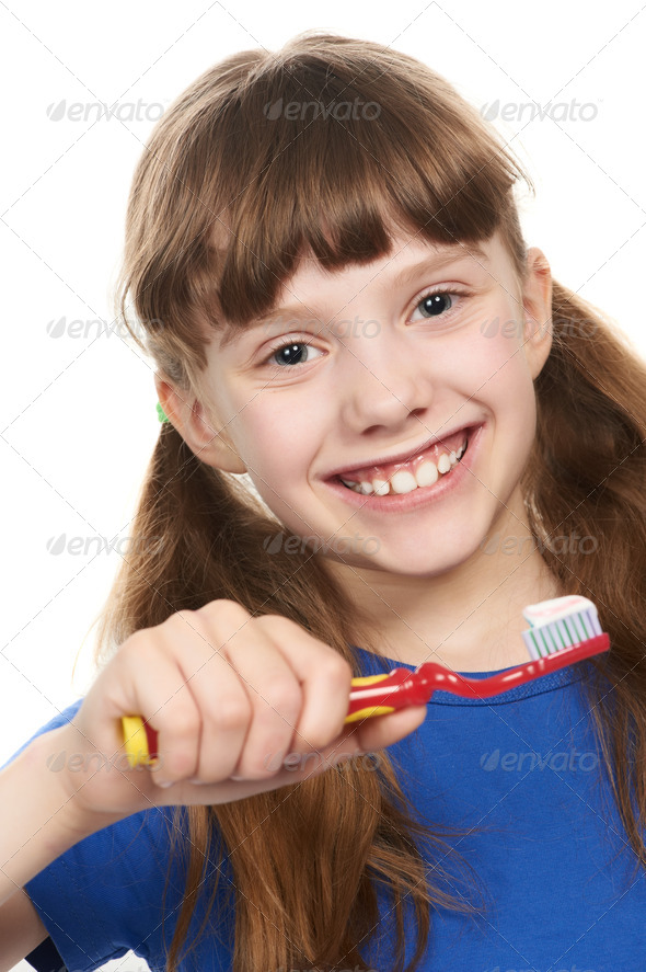 Smiling little girl with toothpaste on toothbrush - Stock Photo - Images