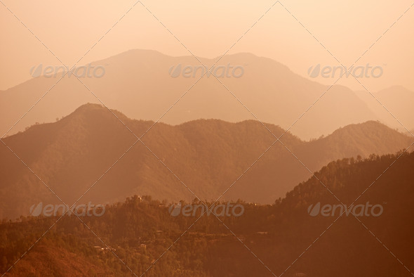 Early morning foggy indian Himalayas mountains - Stock Photo - Images