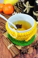 Tea in cup with knitted sleeve - PhotoDune Item for Sale