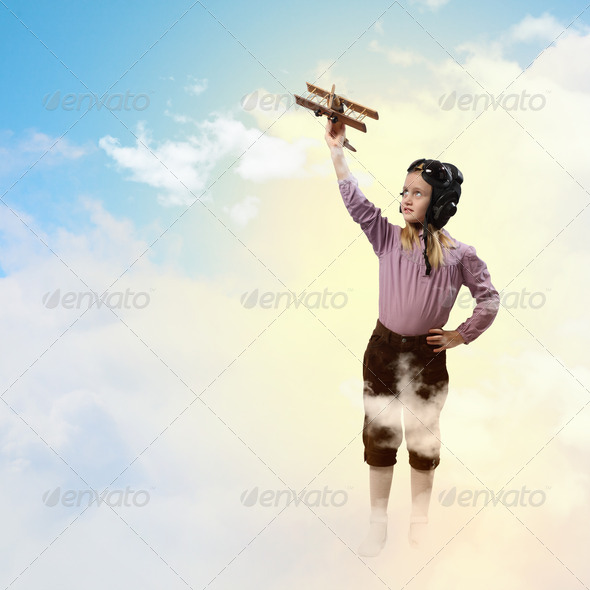 Little girl in pilot's hat - Stock Photo - Images