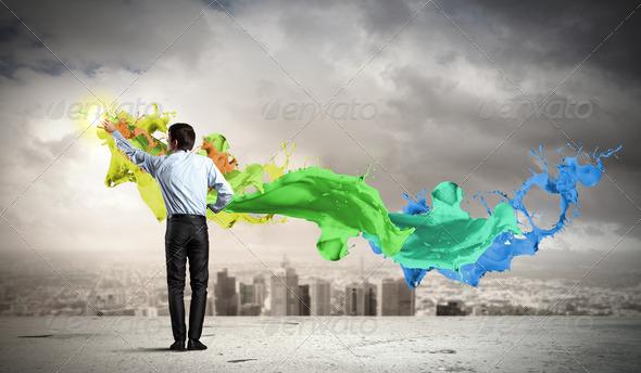 Man painting splashes - Stock Photo - Images
