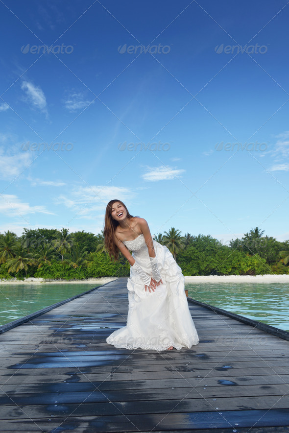 asian bride on beach - Stock Photo - Images
