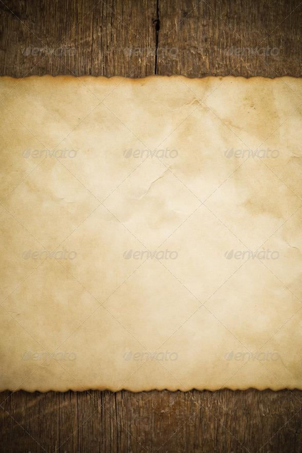 PhotoDune aged paper on wood 3905709