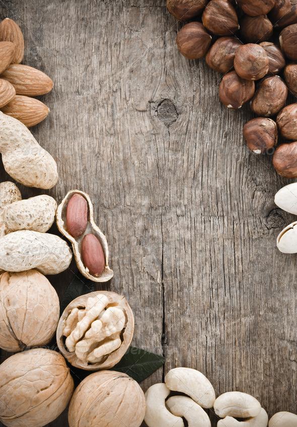 PhotoDune variety of nuts on wood 3905717