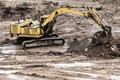 Digging excavator machine at building construction site - PhotoDune Item for Sale