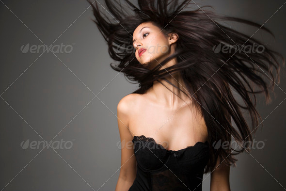 Woman flinging long hair - Stock Photo - Images