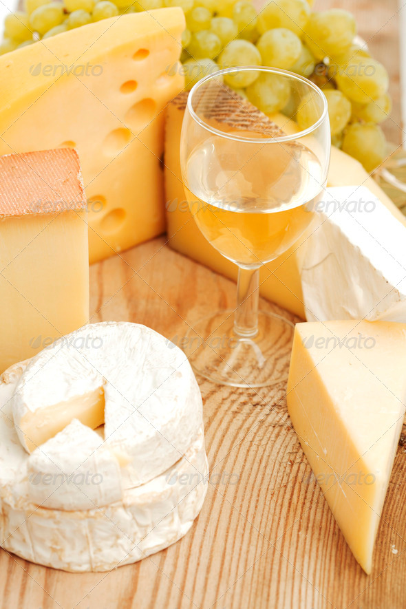 cheese and wine on a wooden table - Stock Photo - Images
