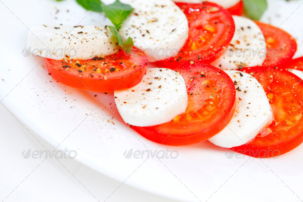 Tomato and mozzarella slices on a plate - Stock Photo - Images