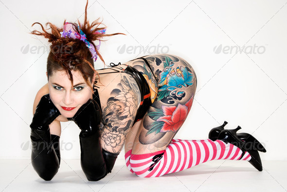 Sassy tattooed woman - Stock Photo - Images