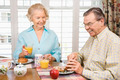 Mature couple eating breakfast - PhotoDune Item for Sale